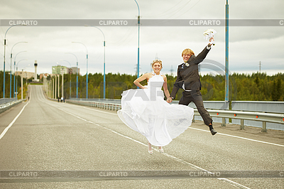 Newly married pair jumps on highway | High resolution stock photo |ID 3147474