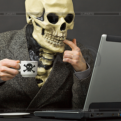 Skeleton drinks poisonous coffee at table with laptop | High resolution stock photo |ID 3148917