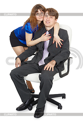 Woman embraces young man in an office chair | High resolution stock photo |ID 3149778