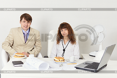 Man and woman meet for dinner at workplace | High resolution stock photo |ID 3153614