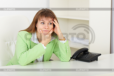 Young woman with concentration thinks on workplace | High resolution stock photo |ID 3156443
