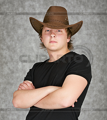 Serious young man in cowboy hat | High resolution stock photo |ID 3160541