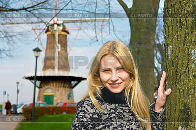 Girl near windmill in Dutch town of Gorinchem. | High resolution stock photo |ID 3328814