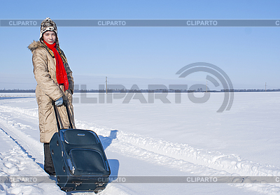 Teen girl with suitcase outdoors at winter time   High resolution stock photo  ID 3162475