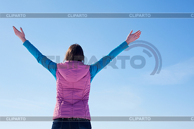 Teen girl staying with raised hands | High resolution stock photo |ID 3223988