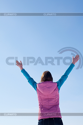 Teen girl staying with raised hands   High resolution stock photo  ID 3223989