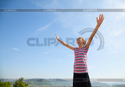 Teenage girl staying with raised hands | High resolution stock photo |ID 3346197