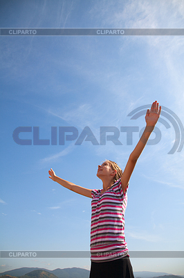 Teenage girl staying with raised hands | High resolution stock photo |ID 3346198