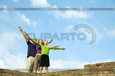 Three young people staying with raised hands | High resolution stock photo |ID 3346209