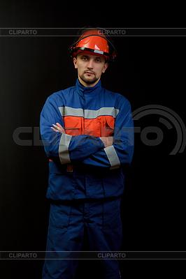 Worker in overalls and helmet | Foto stockowe wysokiej rozdzielczości |ID 3227744