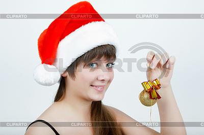 크리스마스 장식과 함께 크리스마스 모자에 소녀 | 높은 해상도 사진 |ID 3350017