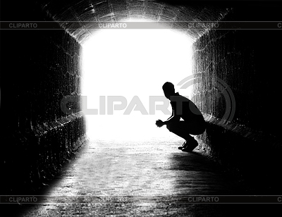 Human sitting silhouette in back-lit in tunnel exit | High resolution stock photo |ID 3292988
