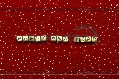 Phrase Frohes Neues Jahr von Perlen auf rotem Samt | Foto mit hoher Auflösung |ID 3299494