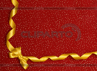 A ribbon and bow on red background | High resolution stock photo |ID 3299498