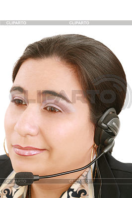 Young beautiful girl in headset,sitting at desk | High resolution stock photo |ID 3360766