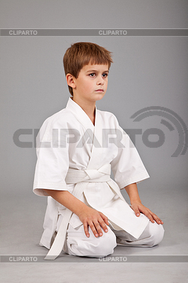 Karate boy in white kimono is sitting | High resolution stock photo |ID 3374993