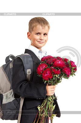 Schoolboy is holding flowers. Back to school | High resolution stock photo |ID 3375538