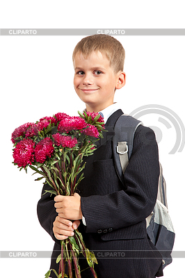 Schoolboy is holding flowers. Back to school | High resolution stock photo |ID 3377589