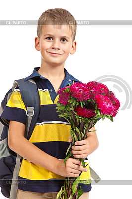 Schoolboy is holding flowers. Back to school | High resolution stock photo |ID 3383877
