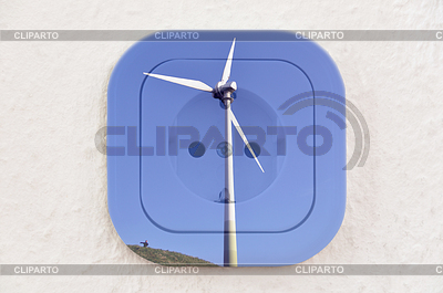Conceptual: Wind Turbine over Power Outlet | High resolution stock photo |ID 3379908